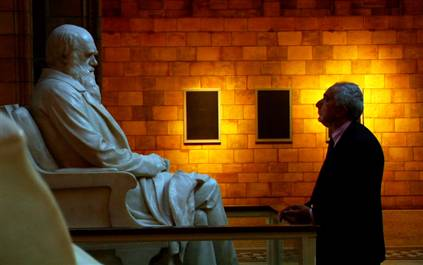 "Ben Stein engages in a staring contest with a statue of Charles Darwin in the so-called documentary ""Expelled: No Intelligence Allowed."""